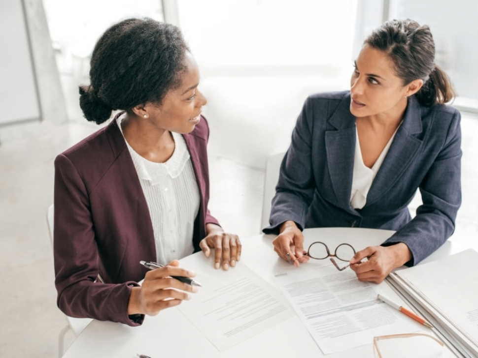 Two women discussing new contract